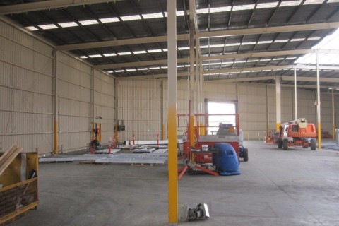 Partially completed roof on one third of the factory