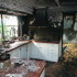 Interior View of Fire Damage to House Kitchen