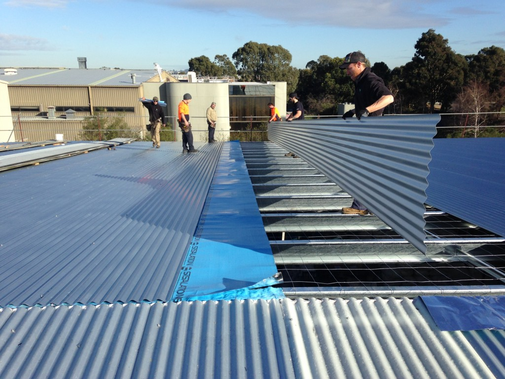 Laying roof sheeting